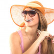 Royalty-Free Stock Photo: Portrait girl in hat looking through sunglasses