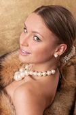 A Beautiful Woman Wearing A Mink Fur Coat — Stock fotografie