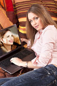 Girl and a computer at home — Stock Photo