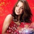 Sexy girl smiles and holding a gift in magic packing — Stock Photo #4038701