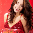 Royalty-Free Stock Photo: Sexy girl smiles and holding a gift in magic packing