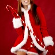 Portrait of beautiful sexy girl wearing santa claus clothes — Stockfoto