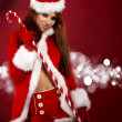 Portrait of beautiful sexy girl wearing santa claus clothes — Stock Photo #4039979