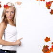 Sexy girl holding a billboard over a white background — Stock Photo