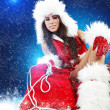 Beautiful sexy girl wearing santa claus clothes — Stock Photo #4244493