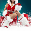 Beautiful sexy girl wearing santa claus clothes — Stock Photo #4244513