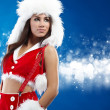 Beautiful sexy girl wearing santa claus clothes — Stock Photo #4244643