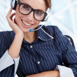 Support phone operator in headset at workplace — 图库照片