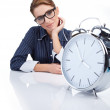 Picture of woman holding big clock over white — Stock Photo