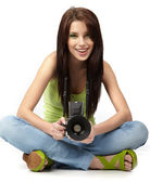 Beautiful young woman with camera. — Stock Photo