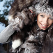 Image of beautiful female in luxurious fur head cloth looking at — Stockfoto #4821900