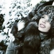 Image of beautiful female in luxurious fur head cloth looking at — 图库照片