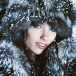 Image of beautiful female in luxurious fur head cloth looking at — Stock Photo