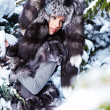 Beautiful and sexy woman in snowy winter outdoors — Stock Photo
