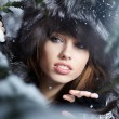 Beautiful and sexy woman in snowy winter outdoors — Stockfoto