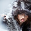 Beautiful and sexy womin snowy winter outdoors — Stock Photo #4825320