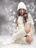 Winterwoman on snow — Stock Photo