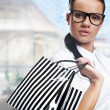 Beautiful shopping woman at a draw mall - Stock Photo