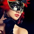 Stock Photo: Beautiful woman with mask