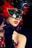 Beautiful woman with mask — Stock Photo