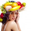 Shot of a beautiful young woman with fruits headwear. Food conce — ストック写真