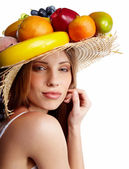 Shot of a beautiful young woman with fruits headwear. Food conce — Stock Photo