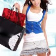 Woman with colorful shopping bags in her hand — Stockfoto