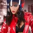 The beautiful girl with a motorcycle helmet — Stock Photo
