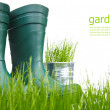 Garden boots with tool and watering — Stock Photo