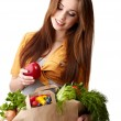 Woman holding a bag full of healthy food. shopping . — ストック写真