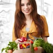 Woman holding a bag full of healthy food. shopping . - Photo