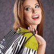 Beautiful woman with shopping bags — Stock Photo #5195329