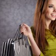 Beautiful woman with shopping bags — Stock Photo #5195517