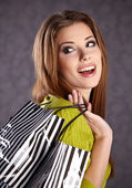Beautiful woman with shopping bags — Стоковое фото