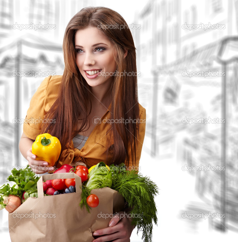 Woman holding a bag full of healthy food. shopping . — Stock Photo #5195214