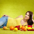 Stock Photo: Young woman shopping for vegetables