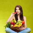 Young woman shopping for vegetables — Stock Photo