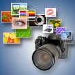 Camera and photographs - Stock Photo