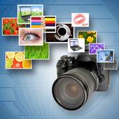 Digital camera and photographs — Stock Photo