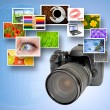 Digital camera and photographs — Stock Photo