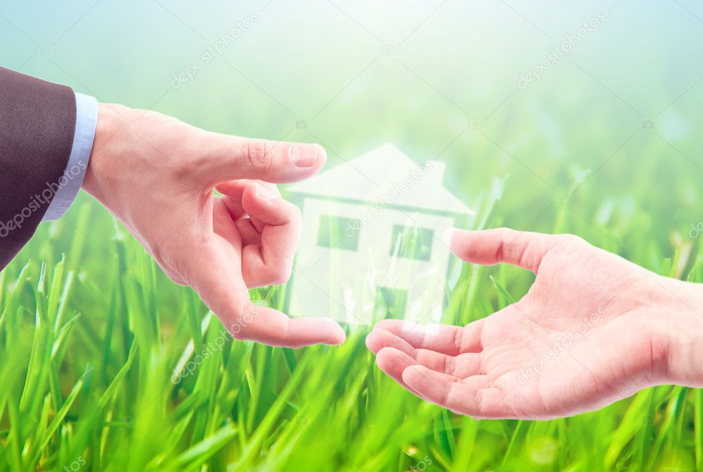 From hand to hand  the house as a symbol of real estate business. — Stock Photo #4673509