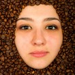 Royalty-Free Stock Photo: Coffee beans around face