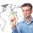Businessman drawing the map of world — Stock Photo #5059653