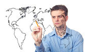 Businessman drawing the map of world — Stok fotoğraf