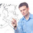 Businessman drawing plane and world map — Stockfoto