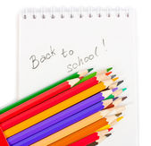 Note book and colored pencils — Stock Photo