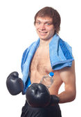 Young caucasian Man boxer with black boxing gloves. — Stock Photo