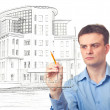 Stock Photo: Men drawing a building