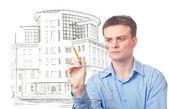Businessman designs a Office Building — Stock Photo
