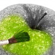 Green apple and brush. — Stock Photo